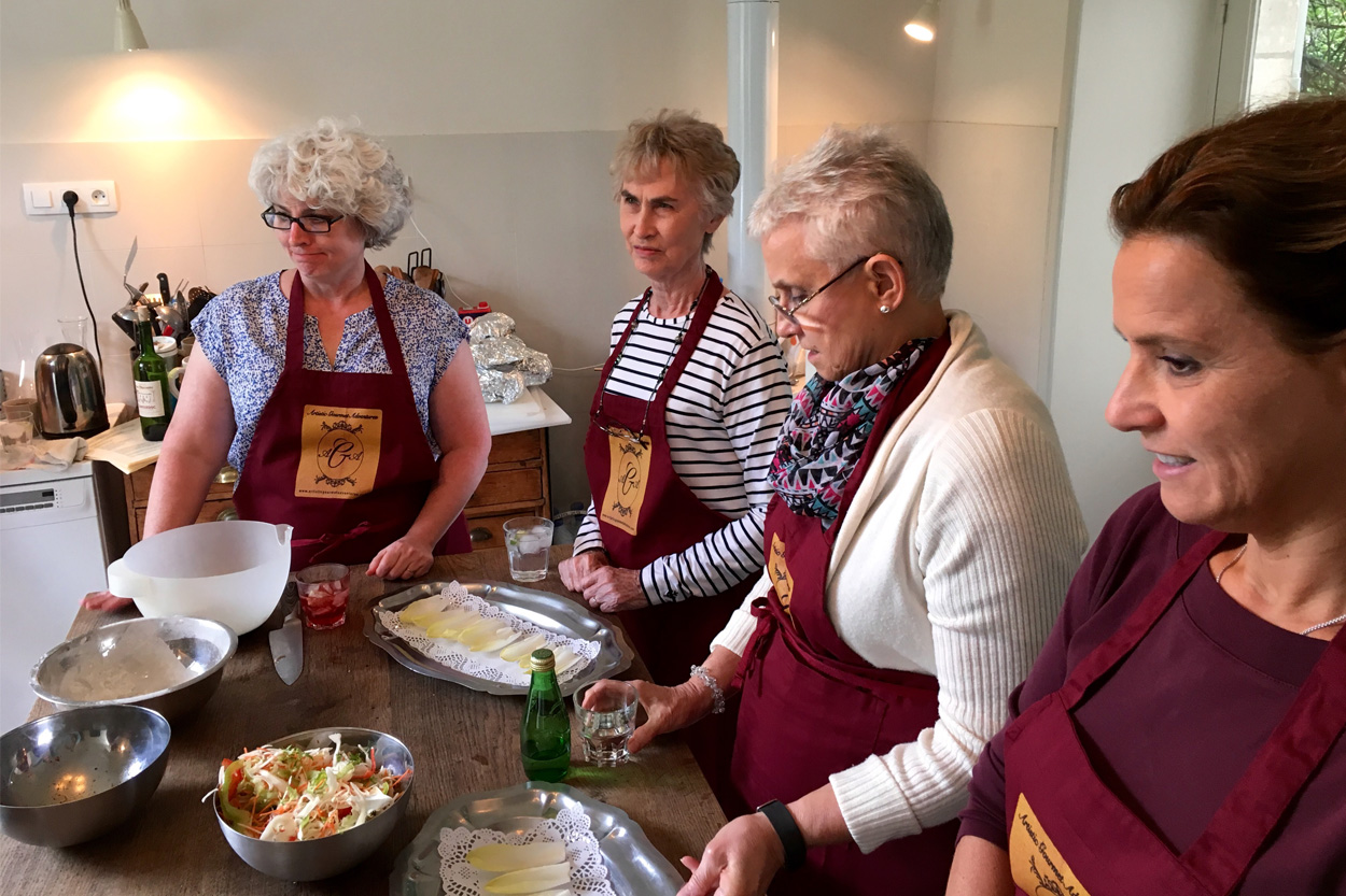 Four cooking class students in the Loire Valley taking cooking classes in a French Kitchen